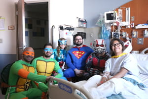 Denver Health Superheroes Meet Patients
