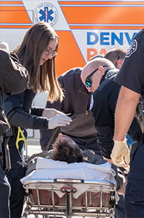 Denver Health Paramedics with patient