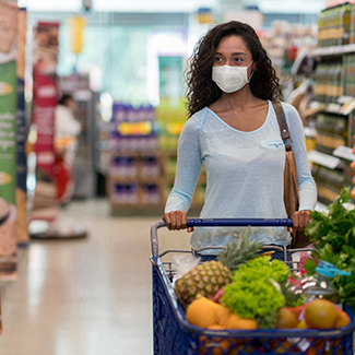 Woman shopping at the grocery store with mask on Denver Health