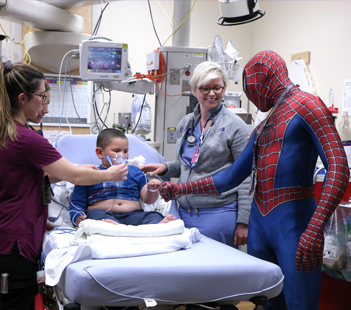 Superhero Spiderman meets with child patient