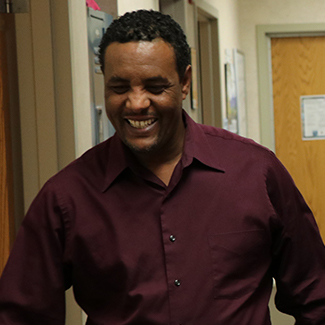 Denver Health patient Kemal Hebano smiles after getting his leg straightened