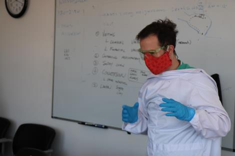 Medical resident shows how to don PPE